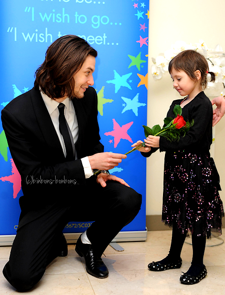 "Ben at the 2009 Make A Wish ""Valentine Dreams Do Come True"" event   This is beautiful. And not even because of Ben, who looks adorable and awkward for probably the first time in his alluring life. This beautiful little girl will always remember getting a rose from Prince Caspian, and that is why the Make A Wish Foundation is completely magical. I've always wanted to get involved with Make A Wish Australia. For my birthday in Winter, I want to have a huge glittery party to fundraise for it. With fairies and alcoholic cupcakes. <3"