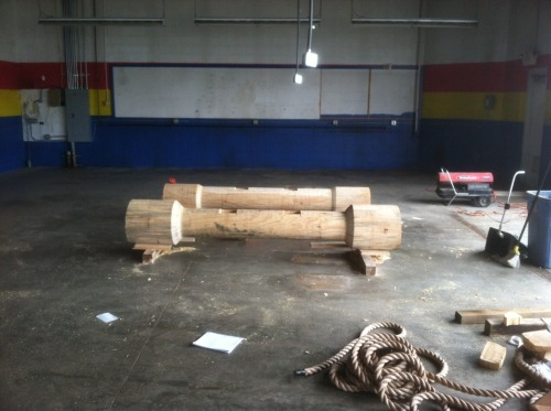 "We are getting ready for the 2012 Arnold Strongman Classic. Under construction is the Austrian Oak"" which will be used for an overhead press from the shoulders. The heavier of the two logs weighs about 450 pounds."