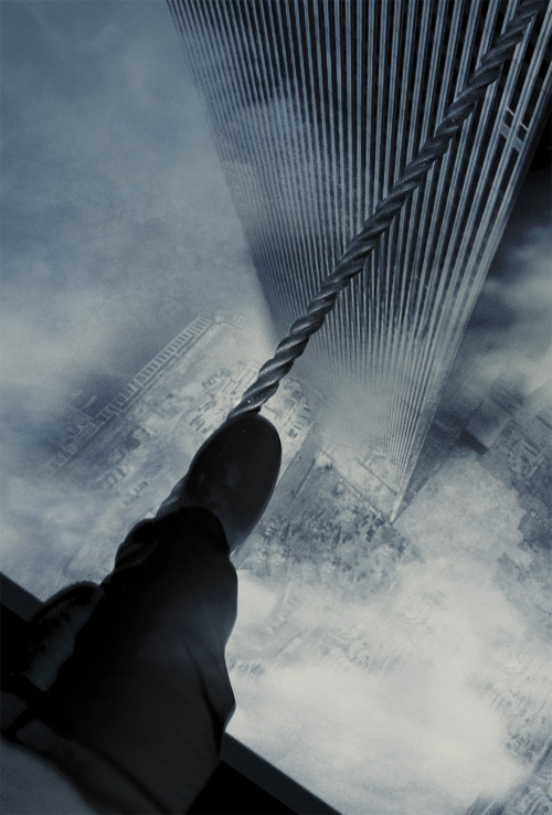 "flakkery:  ""Man on Wire"" Philippe Petit crossing on a tight rope between the Twin Towers, NYC 1974."