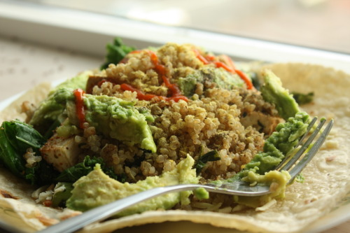My delicious wrap I had for lunch the other day! Quinoa, kale, spinach, grilled tofu, and avocado, topped with sriracha and daiya cheese on a brown rice tortilla!