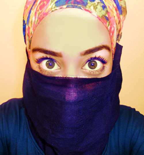 m0roccan:  Saw a lady at Trader Joes wearing her niqab like this with a crazy print and black face veil. She was so beautiful, she smiled at everyone, wrinkles appearing near her eyes every time she did so. First time I've ever seen a niqabi in California outside of the Arab festival.