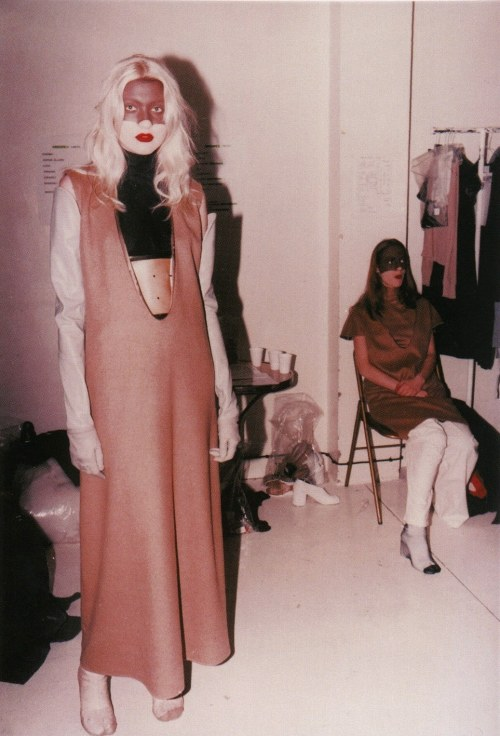 A/W 1996. Women's show. Backstage. Photography: Anders Edström A brown mask was painted on the upper part of the women's faces and their teeth were painted a shiny white.
