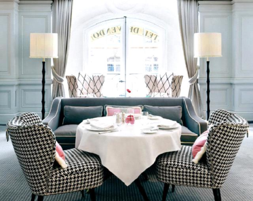 Who wouldn't love to have brunch in the uber stylish room? It's as if a living room transformed itself into a dining experience. The coffee table raised and clothed,and two fabulous armchairs pulled in for a cozy social setting! Great idea for a small space.  I am also in love with the walls and their washed out seafoam colour on top of the panel moulding.