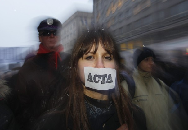 Demonstrators protest against ACTA in front of the  European Union office in Warsaw on Jan. 24, 2012. Protesters wore tape  over their mouths to symbolize their opposition to online censorship.  The treaty's proponents argue that the treaty is a necessary step to  ensure copyright protections online. Peter Andrews / Reuters