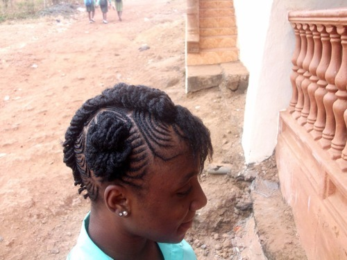 school girl with intricate cornrows