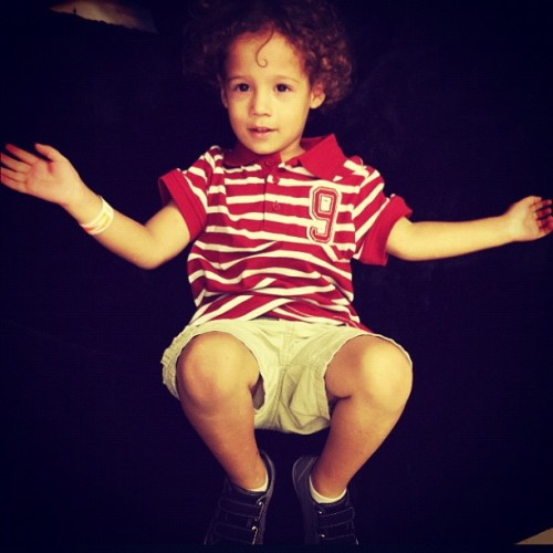 what makes me happy : : my curlyhair son #photoadaychallenge day 11 #makesyouhappy #kids #myson #happy #instagram_kids #febphotoaday #iphoneography #puertorico #instagram #smile #boy #beanbag (Taken with Instagram at San Patricio Plaza)