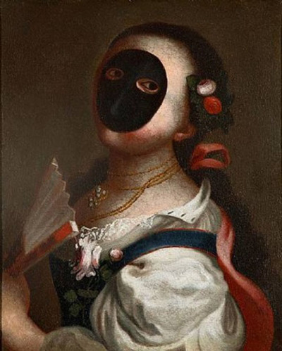 """ornamentedbeing:  """"The Moretta mask is one of the most traditional designs of Venetian  female masks. Originating in France it was quickly taken up by the  fashion conscious Venetian women. It is a dark colored mask (hence the  name, moretta meaning """"a little black one"""") depicting intrigue. The  Moretta mask was oval in shape with no mouth opening, just eye holes.  Traditionally the mask was worn with a veil so giving total anonymity to  its wearer. Originally it was made of black velvet the features are  expressionless. The mask was held in place by biting on a special   button sewn on the inside of the mask using front teeth  so rendering  the wearer mute. This is why the Moretta mask is also called the  Servetta Muta meaning mute maid servant. The lack of verbal communication this mask imposed meant that Venetian  women had to use their body language a lot. It encouraged coquettish  behavior; the tilt of the head, the fluttering of eye lashes, the touch  of a hand all became an intricate part of flirtation. Its expressionless  face meant that the female wearer had to use her body much as a mime  artist would today. When worn, the Moretta mask accentuated all the  attributes that Venetians considered to be the height of desirability  and femininity. In an era where women's views were seen as unimportant  and where the women were judged on their physical attributes alone the  mask accentuated the soft feminine lines of the female face but made its  wearer unable to speak, eat and/or drink. It really speaks volumes  about the treatment of women in the Venetian society. The Moretta mask was worn to gambling houses, for affairs and when  visiting convents where vows of silence were observed. Its popularity  was short lived as by 1760 it had disappeared.. Thankfully todays Moretta masks are designed with ribbon ties to secure  it. They can be crafted from leather, cloth or paper mache. Most are  still blank in either black or white as tradition dictates. The leather  M"""