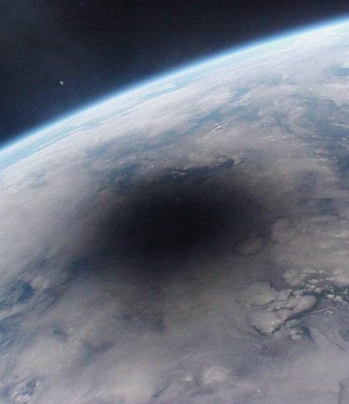 overdosage:  A view of the Earth during a solar eclipse