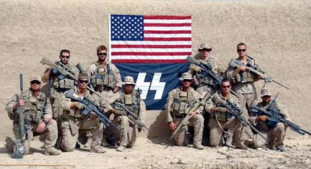 "mehreenkasana:   Marines Sport Nazi SS Flag in Afghanistan The Marine Corps' scout snipers in Afghanistan could probably use a safety stand-down. Just weeks after news broke that one elite unit of the forward-deployed Marines urinated on the corpses of dead Afghans, a photo has surfaced of another unit posing proudly beside a flag of the Nazi's killer SS troops. The Marine Corps Times reports:  The stylized ""SS"" logo appeared in a photograph of the platoon taken in September 2010 in Sangin district, Afghanistan, a hotly contested area in Helmand province. The Marines were with 1st Reconnaissance Battalion, out of Camp Pendleton, Calif. The I Marine Expeditionary Force inspector general based at Pendleton was made aware of the ""SS"" flag photo in November of last year, said Capt. Gregory Wolf, a spokesman at Marine Corps headquarters. The issue has been addressed with the Marines involved, Wolf said. He did not say what specific action was taken beyond ordering Marines to stop using the logo.  The photo in question is not the only one documenting usage of the logo: A second image (embedded below) shows the SS logo emblazoned on a Marine's rifle. The Marines' story is that the unit used the flag ""to identify the Marines as scout snipers, not Nazis."" The symbolic appropriation may indeed be unwitting, but witlessness is no more desirable a trait in downrange warriors than malice is. [Continued]  Great American values like liberty, democracy and progress brought to you in Afghanistan one Nazi flag at a time. And assuming the SS logo does indeed have no affiliation with the Nazi logo, Marine Capt. Brian Block does admit: ""Certainly, the use of the 'SS runes' is not acceptable and Scout Snipers have been addressed concerning this issue.""  Excerpt from an article written by Adam Weinstein and originally published in Mother Jones on Thursday, February 9, 2012."