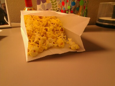 "Day 8: a bad habit.  HAVE I MENTIONED THE POPCORN AT WORK IS AWESOME. also free. This is dangerous.  This could have alternatively been ""saying I'm going to post a picture every day but not doing it."" You get popcorn instead."