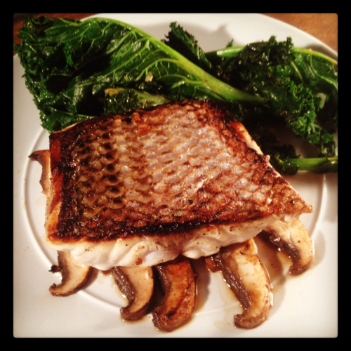 Sea Bass over Portobello Mushrooms with garlic sautéed Kale by yours truly @ home