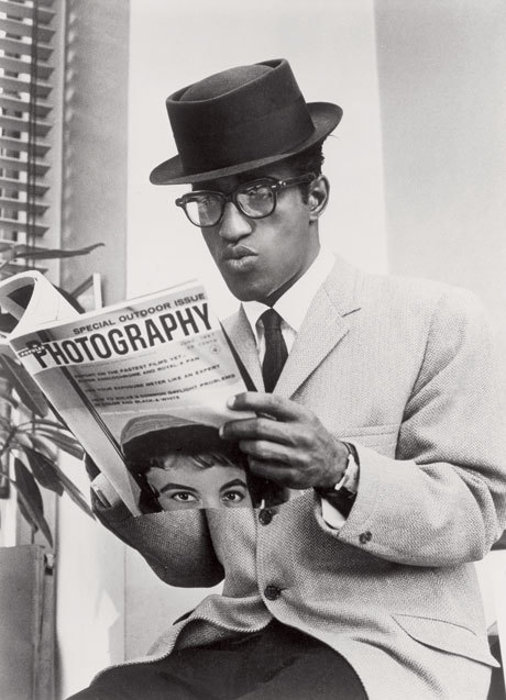 "blackhistoryalbum:  Sammy Davis Jr. | Hollywood Icons & Legend Series Sammy Davis Jr. reading the latest copy of Photography Magazine in between publicity photo shoots in downtown Manhattan, New York City, NY. 1963. Primary a dancer and singer, Samuel George ""Sammy"" Davis Jr. ( 1925 – 1990) started as a child vaudevillian who became known for his performances on Broadway. Davis later went on to become a world famous recording artist, television and film star. Film credits include Ocean's 11, co-staring with Peter Lawford, Frank Sinatra, Dean Martin, and Joey Bishop; Mr Wonderful (1956), and Golden Boy (1964). In 1966, he was even given his own TV variety show, The Sammy Davis Jr. Show. Davis was also a member of Frank Sinatra's ""Rat Pack"". FIND US ON TWITTER 
