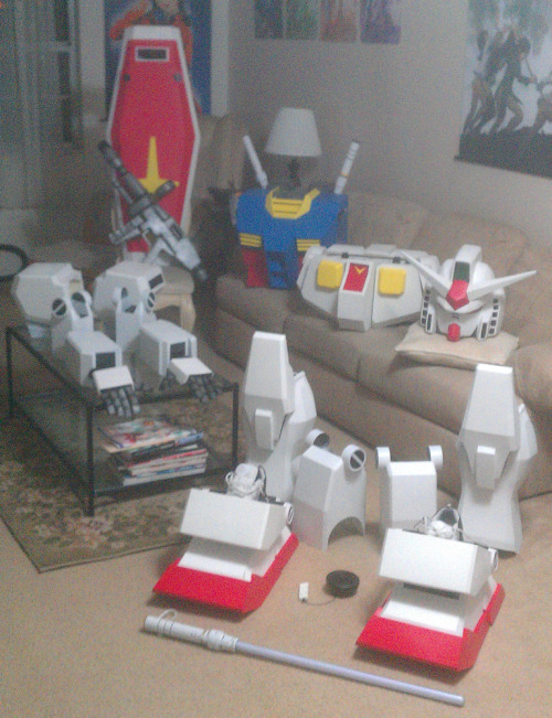 "gundamnit-nigga:   @temjintbw ""RX-78-2 suit ver 2.0 is pretty much complete. Still needs to have speaker mounted and a few very minor paint touch-ups, then its final test fit. Changes from ver 1.0 are added shield and beam rifle. The lighted beam saber can be stored in the shield when not in use. An additional beam saber hilt for backpack added for when lighted saber is not in use. New knee and elbow joints. Completely new torso and backpack. New torso has a hinged rear door that locks with clasps and magnets to allow me to put the suit on more easily than the last version. Redesigned hands to allow for greater range of motion. Black craft foam added to back of the foot section to hide my shoes on the stilts. New paint all around with weathering on the backpack and fingers.See you at Megacon everyone!""  This dude is fucking boss."