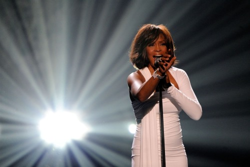 latimes:  Singer Whitney Houston died Saturday in Beverly Hills, according to law enforcement sources.  Authorities are trying to determine a cause of death. It's unclear whether she died at a hotel or in a residence, said the source, who asked to remain anonymous because the investigation is ongoing. Houston, 48, was in the Los Angeles area for a musical tribute to music executive Clive Davis and had performed and spoken to reporters earlier in the week.  Photo: Whitney Houston in 2009. Credit: Getty Images