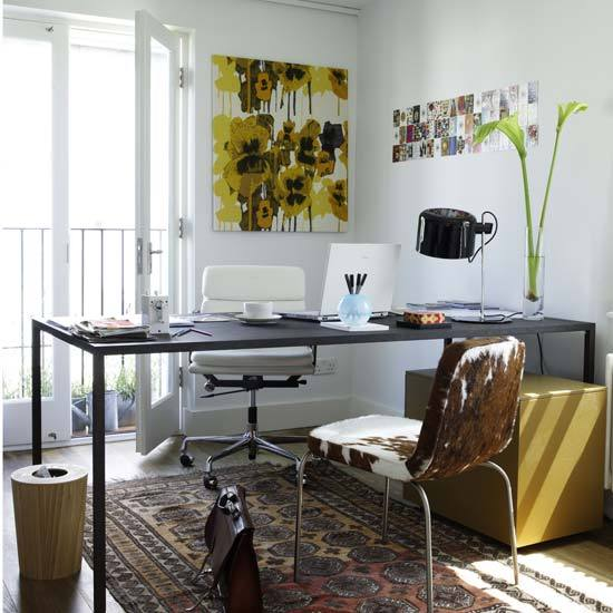wellappointeddesk:  Lots of great office/studio inspiration to be found on this post from From the Right Bank including this simple tabletop with contrasting filing cabinet and cowhide guest chair. (via FROM THE RIGHT BANK)