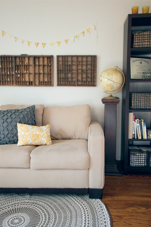 (via sneak peek: amanda wright of wit & whistle | Design*Sponge) I've seen these wood knickknack shelves often but I knew I didnt have enough little items to fill then. Turns out they look great mostly empty!
