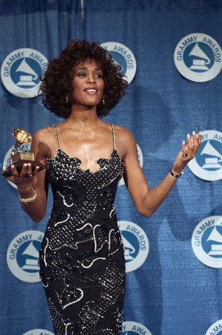 Whitney Houston with her 1988 Grammy Award for Best Pop Vocal on March 2, 1988. Photo via Corbis.
