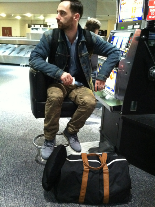 "jenini:  Handsome. And yes that's my carry on ""purse"" that he was kind enough to carry"