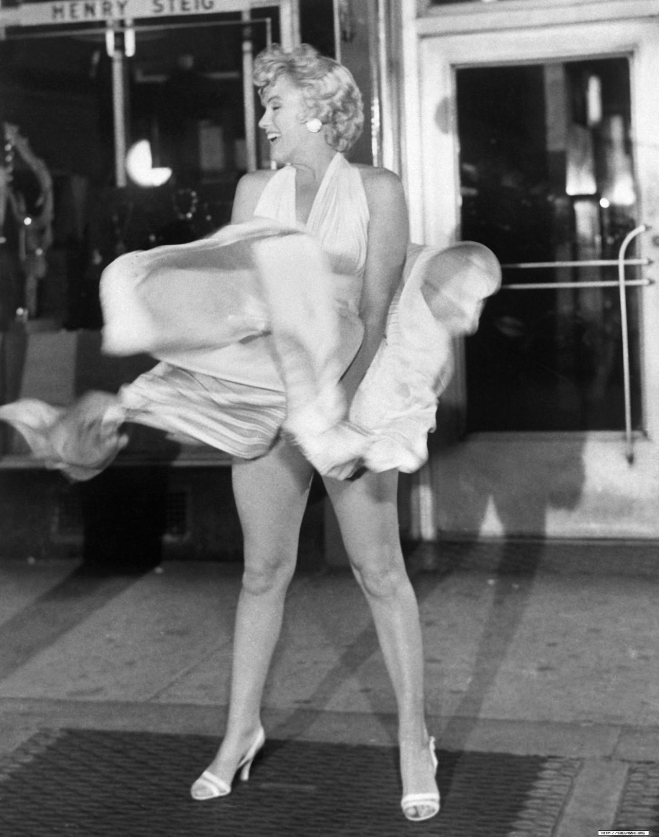 Marilyn Monroe filming the infamous subway grate scene in The Seven Year Itch in 1954