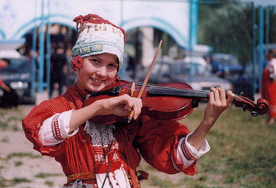 Russia by Ted Walls This Child is not at the Orphan.  She has parents and they dress her up in a Russia folklore and plays music on the streets for money to help. She was very good too.