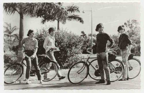 The Beatles cycling.