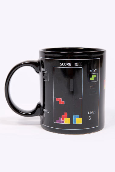 pwnlove:  Wake up every morning to a little Tetris. Heat Changing Tetris Mug by Urban Outfitters (UK) Available for £10.00