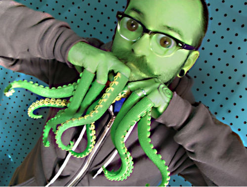 Ever since he put on the Cthulhu Finger Tentacles, Dan'l seems different… [via Archie McPhee]