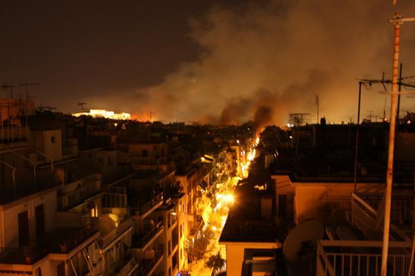 A combination of tear gas and smoke from fires fill the sky in Athens, Greece as a night of rioting continues. [via Twitter]
