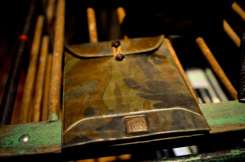 Two Inch Cuffs - Journal - LOGAN ZANE x BKC Camo iPad Case  Leather brand Logan Zane and Brooklyn based Brooklyn Circus have constructed a new line of luxury men's accessories as apart of a collaborative project focused around camo. With a unique twist to their classic product, their camo leather Ipad case do more than catch the eye. Inspired by a manila envelope that has a variety of modern components of camo and hunter orange, this cover unifies a manly man's Ipad protector with chic accents. Logan Zane continues to grow steadily with something aesthetically pleasing.