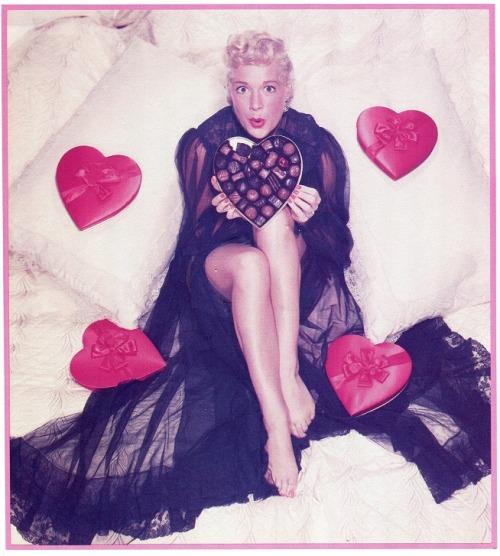 From a book on Hollywood Pinups, Betty Hutton wishes you a happy Valentine's Day.  Take Betty's advice, eat some chocolate and put on a smile.