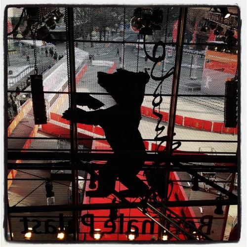 My first day at the Berlinale, a few considerations: You really can tell the difference between -10°C and -17°C. Snow is forecast for tomorrow, which should bring the temperatures to a toasty -4°C. The first thing I saw this morning on my way to the Berlinale Filmpalast was a photograph of Fritz Lang on the main facade of the Deutsche Filmothek. That made me feel so good about this place. Until I spotted a photo of Brad Pitt in Inglourious Basterds right next to it. Oh, yeah, Brad Pitt is in town. Brillante Mendoza's latest film, Captive, really didn't put me in the mood for boarding the first flight to the Philippines, not so much for the kidnappings, more because of the snakes. Ghhh. On the other hand, Spiros Stathoulopoulos' Meteora (shot in the Greek monastic site of the same name) made me want to travel there. Mostly in order to tell a better story about the place than the one he chose, which is a pretty standard fable of erotic passion vs spiritual devotion. (Something that Lorca, for instance, was much better at writing - unaided by quirky but dodgy animated Orthodox icons. That's exactly what I mean.) Highlight so far: the Romanian film Everybody in Our Family. It's a film about family dynamics and aggression between parents and children. It's a black comedy infused with a sense of domestic menace that wouldn't be out of place in a Haneke film. It's terribly unnerving and dangerous, and yet very, very funny. I loved it. I'm terrified some American producer will see it and want to remake it with Adam Sandler in the lead, so do see it before something awful like that happens.  The wi-fi provision here hasn't quite made it into the 21st century. Haven't really spent any time exploring the magnificent Hauptstadt, apart from a lovely walk in Schöneberg at 8am this morning, followed by a spectacular U-Bahn ride between Nollendorf Platz and Potsdamer Platz - sun glowing bright through the frosty haze, only a few film buffs out in the streets, braving the icy temperatures. Angelina Jolie is a joke.