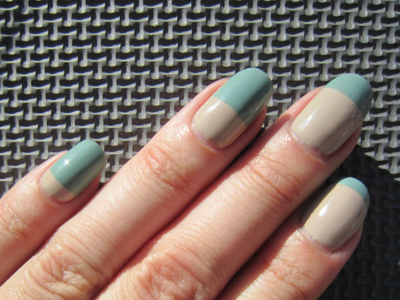 fuckyeahnailart:  (via Concrete and Nail Polish: Zoya Bevin & Some Easy Nail Art) Definitely different. Not sure I'd wear it but I definitely love how she did it! I think the key to this style is picking two colors that are fairly neutral and very similar to each other.