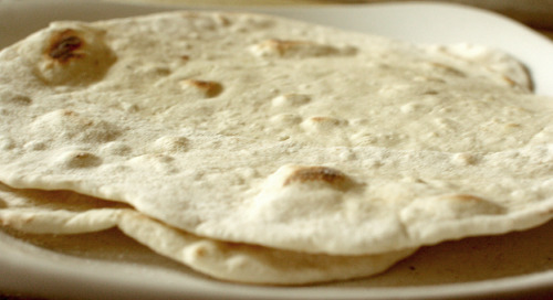 The 40 Calorie Flour Tortilla  Ingredients: 1/8 Teaspoon Salt .5 oz Water 1/4 Cup Flour 1/8 Teaspoon Baking Powder Servings: Creates 2 Tortillas (1 Tortilla = 1 Serving) Nutritional Facts: Calories Per Serving: 41.25 cal Fat (g) per Serving: 0.00 g Carbs (g) per Serving: 8.63 g Protein (g) per Serving: 1.13 g Sodium: 32.50 mg Directions: Combine all ingredients into a bowl and mix. Dough should combine in to a single ball. If this doesn't happen, add a little more water incrementally until it does. Cover the dough with a wet towel or cloth for ~15 minutes. Split dough into two balls. Roll into round shapes. Flour the counter. Take each ball and roll out into a very flat circle. Take each circle and place onto an ungreased skillet. Cook over medium heat until tortilla starts to show brown spots.