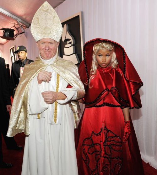 Blasphemous Fashion: Nicki Minaj at the Grammys When fashion meets trying too hard, you get Nicki Minaj and her entrance to the grammys. I wonder what the Pope has to say about it.  I'm not offended, but I do know a lot of people are. It's verging on Blasphemy without a single thing being said.  Thoughts?  Source: sent in by Anonymous user - thank you!