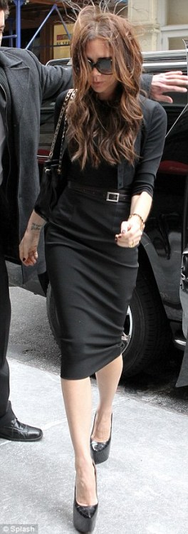 Cardi Girl: Victoria Beckham Victoria Beckham arrives at the New York Public Library for her fall 2012 show on Sunday. Doesn't she look smashing? Photo: Daily Mail/Splash