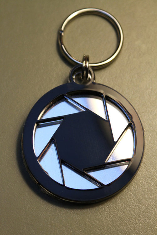 Aperture Science logo Mirrored Key-chain by NightmareonCraftSt  One of my recent purchases from etsy.