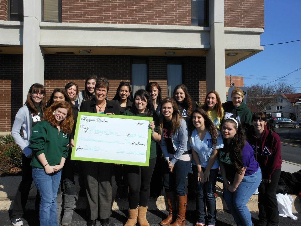 Eta Lambda delivers a hefty check of $2112.62 to Bridge of Hope Lancaster and Chester Counties.  The sum was accumulated from our yearly Shamrock the Stage event!