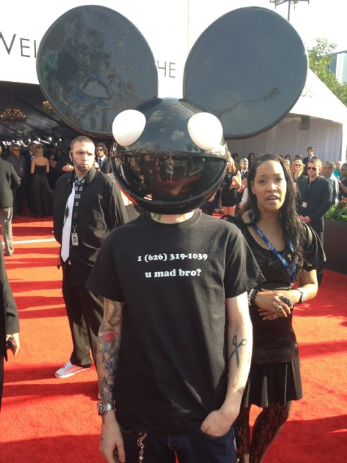 "thedailywhat:  Grammys: ""Maximum trolling achieved"": Deadmau5 showed up at the Grammys wearing Skrillex's personal cellphone number on his T-shirt. [@deadmau5.]"