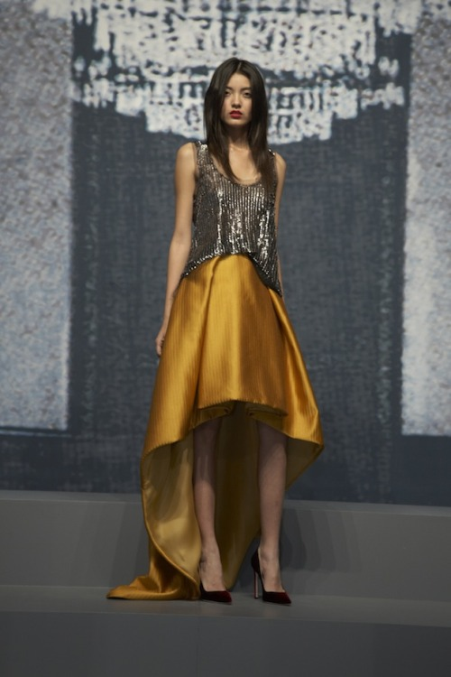Best I've seen yet during New York Fashion Week Fall 2012! Designer: The young and talented Wes Gordon. I love it! I love hem….high-low. MUSTARD YELLOW..my favorite color to wear and a gunmetal sequin top to finish it off. What else can I say?!