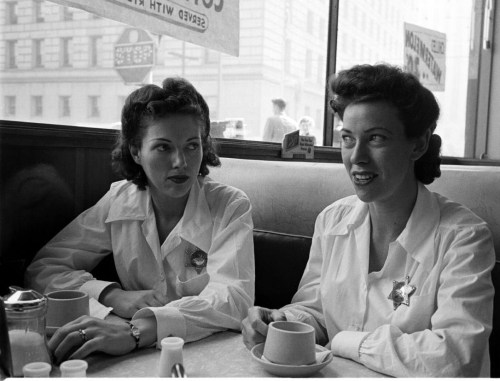 Female police officers getting coffee at a diner. Photograph by Peter Stackpole. Los Angeles, California, November 1950.