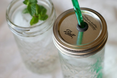 unconsumption:  Adding to the growing group of jar reuses with these three finds: 1. Jar tops with holes in them enable you to more easily carry drinks (read: less likely to spill them), especially when you're on the go. The reusable/refillable jar-glasses pictured above, via PoppyandPearlCo on Etsy, come with reusable, BPA-free straws. (Spotted on Pinterest, via TreasureAgain.) 2. BPA-free, reusable (and recyclable) Cuppow screw-on tops also make it easier to carry beverages with you, without spilling them.  3. This next idea — cutting off the tops of salt containers and placing them onto the tops of jars — made the blog and Pinterest rounds several months ago. Still brilliant. (via Pinterest; click through for a brief tutorial)
