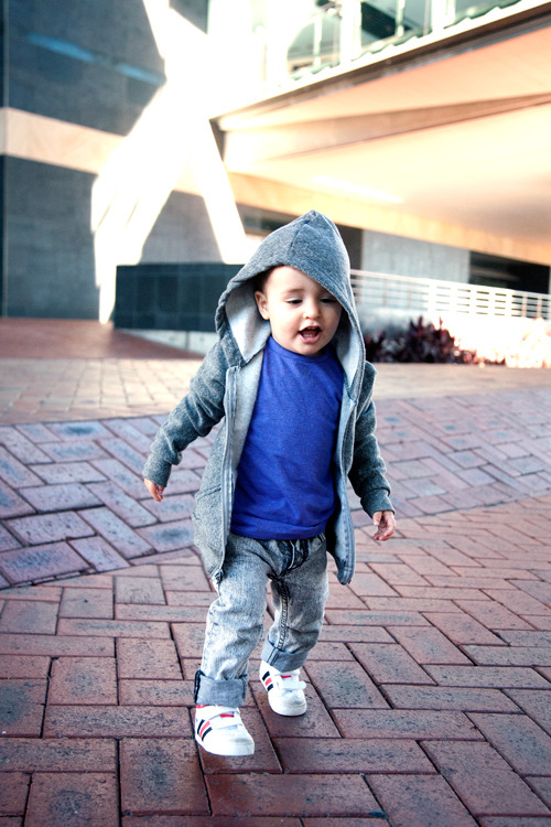 Submission from Marshall at www.tinysartorialist.com :) All swag in over-sized hoodie and acid wash jeans.