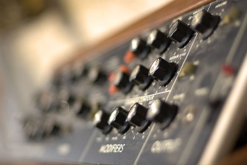 Vintage Synth: the Minimoog Model D 'Modifiers', 'Frequency cutoff, 'emphasis' 'envelope', - a whole new vocabulary for musicians in 1970. Designed by Robert Moog in 1970, the Minimoog Model D synthesizer is still regarded as the Rolls Royce equivalent of analog keyboard-based synthesizers. Specifically designed for touring musicians, the minimoog exported electronic music experiments from university labs out to the masses - and her deep farting bass-sounds (think of Kraftwerk's Autobahn), lead and space bleeps and sweeps have become HUGELY popular over the last 38 years. There were originally 13,000 minimoogs produced between 1970 and 1981. After a brief hiatus during the digital-synth craze in the 1980s, the minimoog enjoyed a resurgence of interest among musicians since the 1990s…and yes, it's becoming harder to get a hold on one. read more