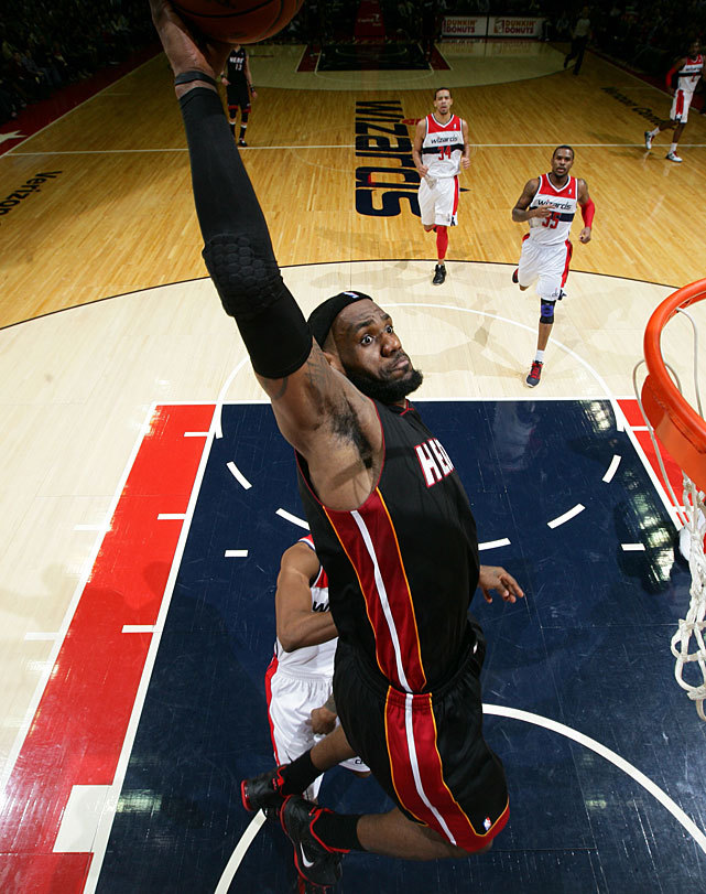siphotos:  Heat forward LeBron James flies in for a dunk during Friday's game against the Wizards. James scored 18 points as Miami prevailed 106-89. (Ned Dishman/NBAE via Getty Images) MANNIX: A Western snub highlights my issues with this year's All-starsGALLERY: Photos of the 2012 NBA All-Star Starters