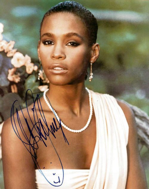 "Whitney Houston 1963-2012 Thank you for blessing us with your gifts! Through your success and your trials you've always held on to Christ! Thanks for inspiring us! Still can't imagine a world without you! I'm pretty sure you are in great company in heaven! We love you, Whitney!!! Wish the world would have showered you with more love while you were here….that is our loss. Now you are free to sing amongst the stars!!!! Well DONE, SIS!!!! Check out Whitney singing her signature song, ""I Will Always Love You:"""