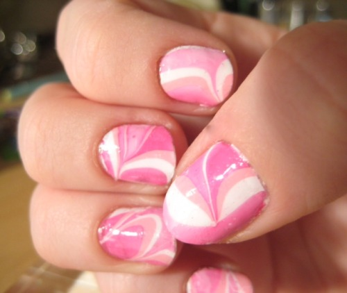 Valentine's Day Water Marbling- http://notesandnails.tumblr.com/post/17432753284/valentines-day-water-marbling