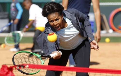 Show 'em how it's done. Michelle Obama engages in some mini-tennis over the weekend.