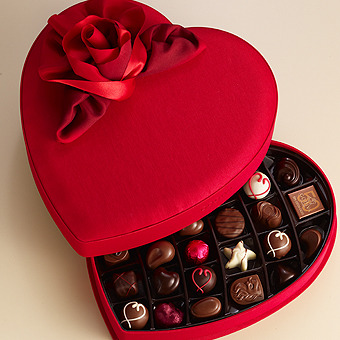 unconsumption:   During Valentine's week, Americans are expected to buy more than 58 million pounds of chocolate candy. And more than 36 million heart-shaped boxes of chocolate will be sold, according to the National Confectioners Association. (Via Detroit Free Press | freep.com. Emphasis mine. Photo via Godiva.com.)  .. Valentine's Day. Great, my regular dip of faith in humanity was overdue - http://bit.ly/vZdHeJ #ThatAnnoyingFeeling #fuckvalentines