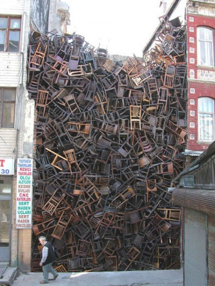 orabird:  Doris Salcedo (Colombia, 1958-) This piece was installed at the 2003 Istanbul Biennial using 1,550 wooden chairs.
