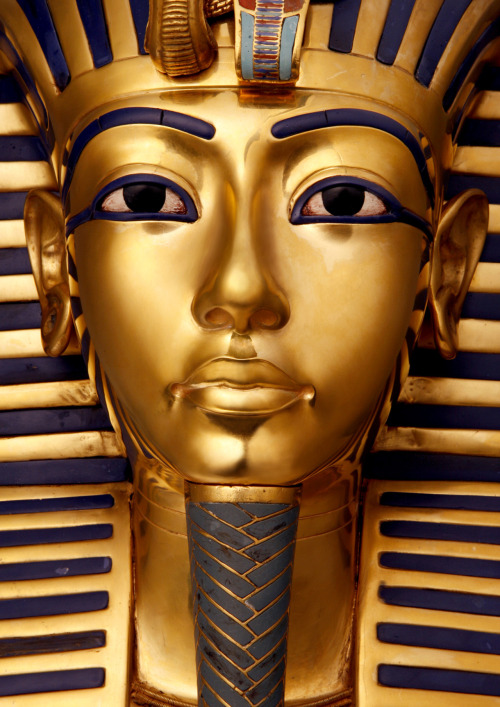 The Death Mask of King Tutankhamun, made of solid gold and inlaid with colored glass and precious stones. The mask comes from the innermost mummy case in the pharaoh's tomb, and stands 54 cm (21 in) high.